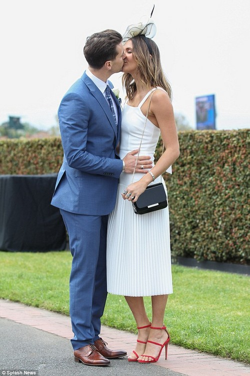Sealed with a kiss! Matty Johnson and Laura Byrne locked lips at Caulfield Cup Day on Saturday