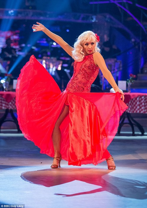 Red hot!Debbie was the picture of confidence as she posed on the carpet, and enjoyed a night away from her successful stint on Strictly Come Dancing so far (above)