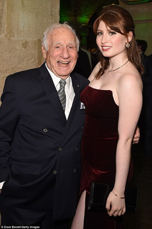 Dream team:The budding actress turned heads in a slinky burgundy velvet gown, complete with thigh-high split, as she helped her relative celebrate the big achievement