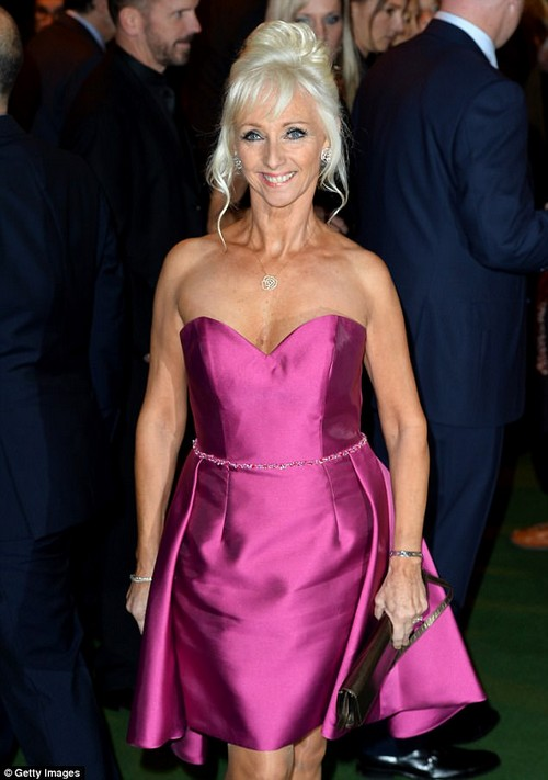 Leggy lady:Debbie looked younger than her years in the chic pink frock, which cut off just above her knee to leave her impressively slender legs on show