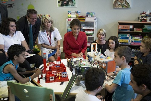 Melania Trump talks to children while visiting the Necker hospital, France's biggest pediatric hospital, which is in Paris this past July