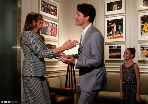 Melania Trump and Justin Tr udeau greet each other as Trudeau's daughter, Ella-Grace, looks on. Trump made her first solo trip to Canada to attend the opening ceremony of the Invictus Games in Toronto this past September
