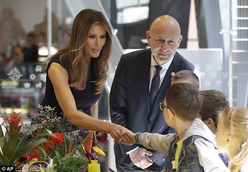 Melania Trump shakes hands with a young boy during a visit at the Copernicus Science Center, an interactive science museum in Warsaw, Poland this past July
