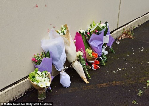 The heart-breaking note of regret was left with bunches of flowers and other letters at a makeshift memorial for the 34-year-old on Wednesday (pictured)