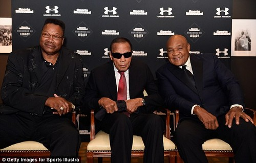 Larry Holmes (left) has even flown over to the UK for the launch of Ali's Tag Heuer watch