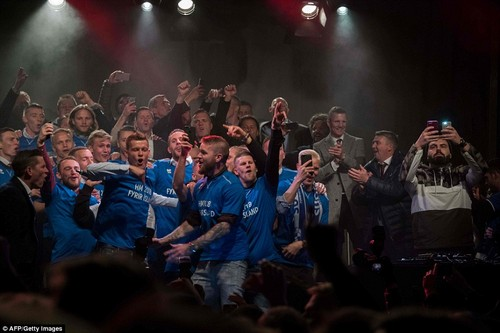 Iceland's stars jump up and down on stage after beating Kosovo 2-0 to seal their first ever appearance at a World Cup