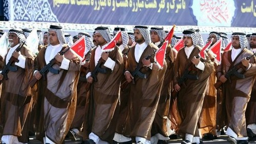 Iranian Arabs who are members of the paramilitary Basij force march in a military parade marking the 37th anniversary of Iraq's 1980 invasion of Iran, in front of the shrine of late revolutionary founder Ayatollah Khomeini, just outside Tehran, Iran, Friday, Sept. 22, 2017. Iran's Revolutionary Guard has unveiled its latest ballistic missile with a range of 2,000 kilometers — about 1,250 miles— capable of reaching much of the Middle East, including Israel. (AP Photo/Ebrahim Noroozi)