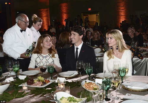 Trudeau sat between his wife, Sophie, and Trump as they enjoyed dinner their dinner together on Tuesday evening as part of the three-day Fortune summit