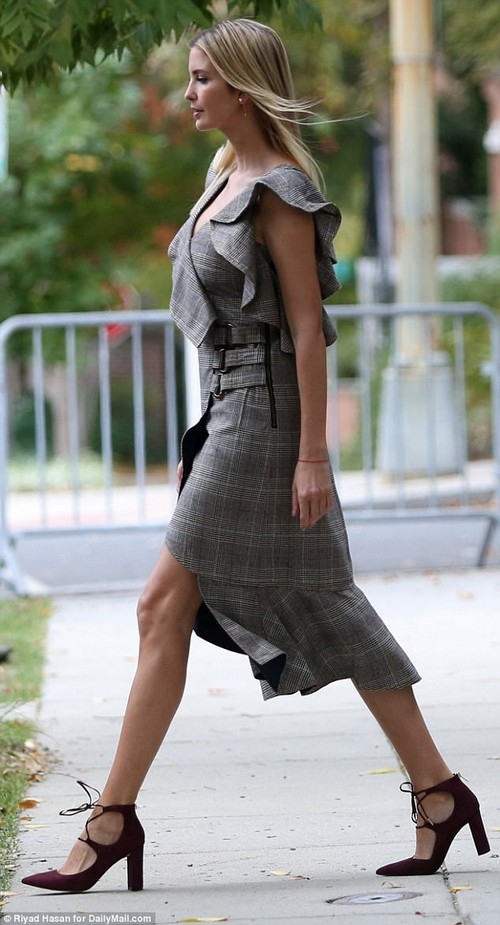 Print: Ivanka seems to be loving plaid at the moment, and she stepped out of her house this morning donning the print for the third time in four days