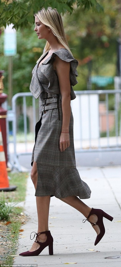 Garment: The first daughter was pictured leaving her house in Washington, D.C., modeling a black and white dress with a thin plaid pattern