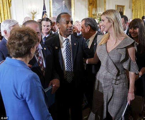 Catching up: Ivanka had her arm around Housing an Urban Development Secretary Ben Carson while chatting with him at the event