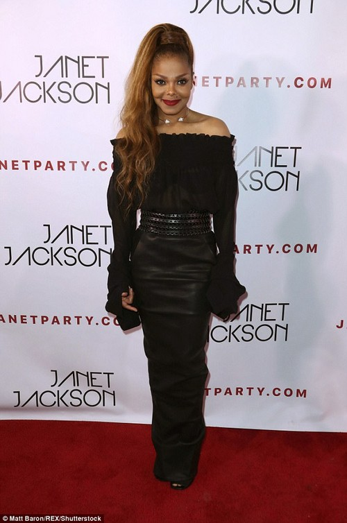 Looking good:Janet Jackson, 51, looked to be defying age as she showed off her youthful visage and svelte figure at a party following her concert in Los Angeles on Sunday