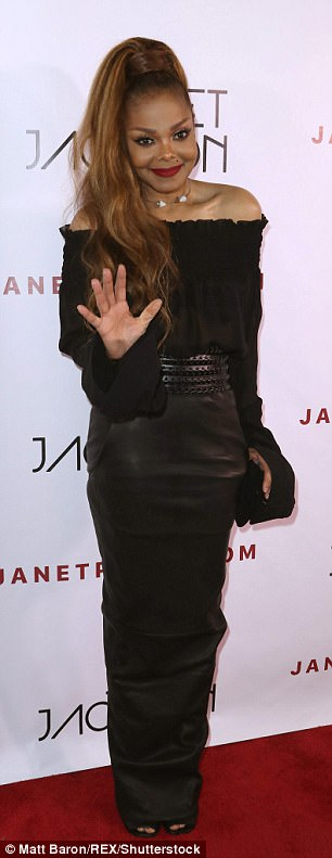 Wowing the crowds: Janet paired her skirt with a classy off the shoulder ruffled blouse with flared arms. The ensemble was cinched with a glam black belt to reveal Janet's tiny waist