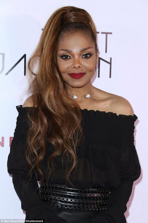 Flawless:The veteran songstress completed her stunning look with powerful make up to accentuate her striking facial features, including slicks of dark eyeliner and crimson lipstick