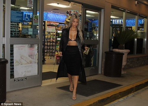 Sweet tooth:Kim ensured all focus on herself in the raunchy see-through bra which struggled to contain her ample assets