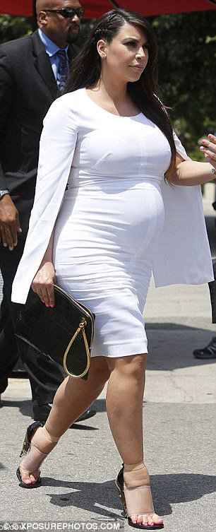 Not breaking a sweet anymore! The beauty icon was bare-legged and wore her favourite pair of towering perspex heels - which proved to be a better fit than when she donned them in 2013 during her first pregnancy (R)