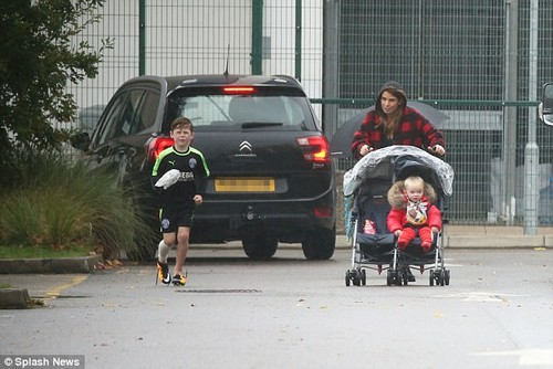 Glum: Her appearance comes just days after Coleen was pictured ditching her ring as she took eldest son Kai, seven, to football training, watching from the sidelines with 4-year-old Klay and 1-year-old Kit