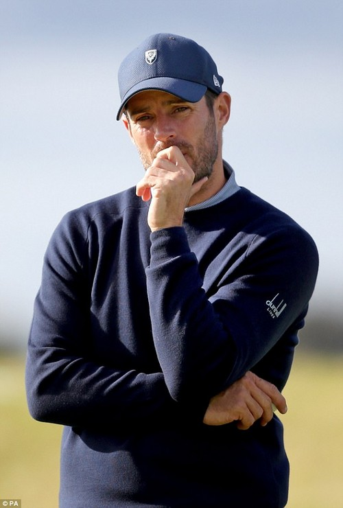 Ringless: The same day Louise showed off her flexibility her husband Jamie was seen without his wedding ring for the second day in a row at theAlfred Dunhill Links Championship