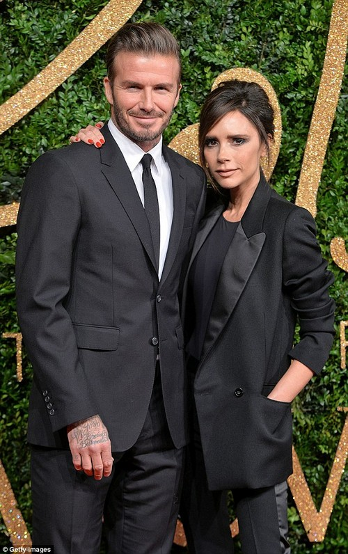 In comparison: His earnings come his wife Victoria's fashion brand was said to have filed a loss of £4.6million in January (Pictured in 2015)