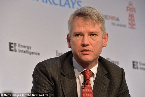 BAE chief executive Charles Woodburn (file image) announced almost 2,000 job cuts at the major defence firm,insisting it would give BAE a 'sharper' edge