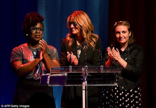 Dunham recalled her own sexual harassment and said she had heard stories from victimized women 'at a rate that feels positively dystopian' (Pictured, left to right,Uzo Aduba, Julia Roberts and Dunham at The Hillary Victory Fund Stronger Together Concert in October 2016)
