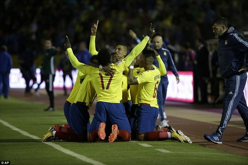 The home side celebrate their opening goal in front of the Argentina bench. Their lead was short-lived in a dramatic first-half