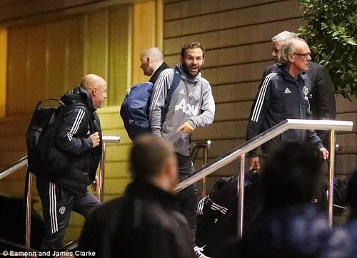 Juan Mata smiles for the cameras as the United players get together before playing Tottenham