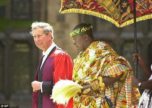 Ghana International Bank bigwig Mark Arthur was summoned to Osei Tutu II's multi-million-pound home in Henley-on-Thames and given £200,000 in sterling as well as $200,000 and told to deposit the funds (pictured with Prince Charles, 2001)