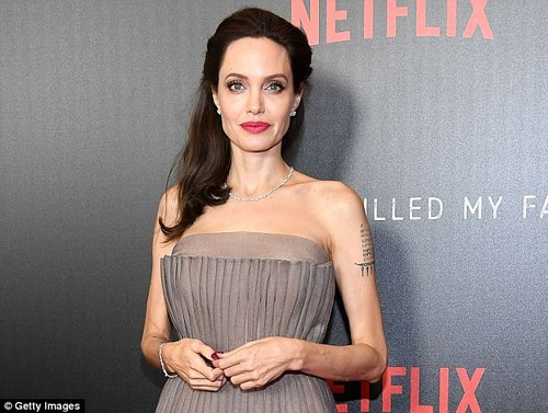 Angelina Jolie (above in September) said that she never worked with Weinstein again after her made unwanted sexual advances on her while filming 'Playing by Heart'