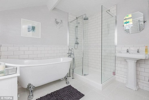 This neutral bathroom features in a four-bedroom detached house in West Yorkshire's Ossett, which is on the market with estate agents Yopa for £500,000