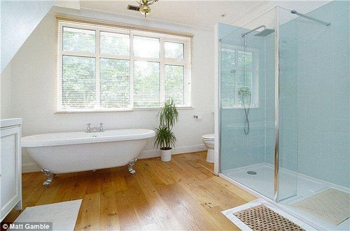 This luxury bathroom is in a six-bedroom detached house in London's Corringway, which is for sale via estate agents Yopa for £1,675,000