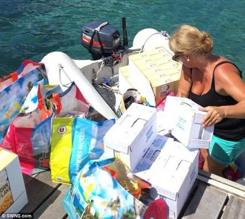 Helping hand: Tracy pictured handling emergency supplies for victims of Hurricane Maria