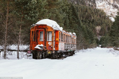 Stranded: A railway carriage sits frozen in snow as a fierce winter on the Pyrenees mountains takes hold