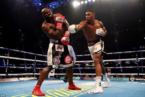 A resilient and battled-hardened Takam recoils after taking a big hit from Joshua but soaks up the pressure