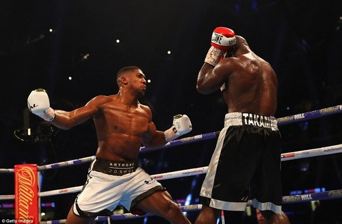 Joshua keeps the pressure on full throttle and lunges at Takam at optimum force as the challenger braces himself for impact