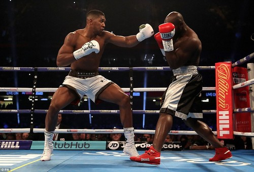 After Takam connected with Joshua's nose with his head, the world heavyweight champion turned up the pressure