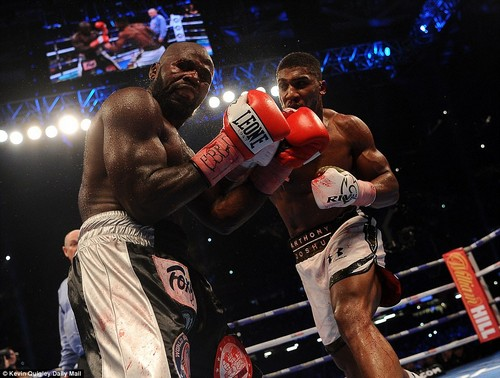 Pain is etched across the face of a blood-spattered Takam as the contender takes a heavy punch in the latter stages