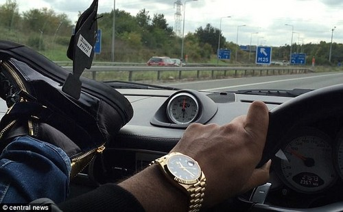 An Arab ¿bling king¿ filmed himself with his feet on the dashboard (shown) of his Porsche Carrera Turbo S while driving at 180mph with his feet on the dashboard
