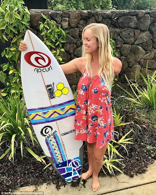 Determined: She lost her arm at age 13 while surfing in Hawaii with a friend