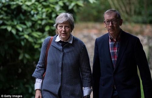 The Prime Minister, pictured going to church in her Maidenhead constituency with husband Philip yesterday, has indicated she will not shy away from reshuffling her top team