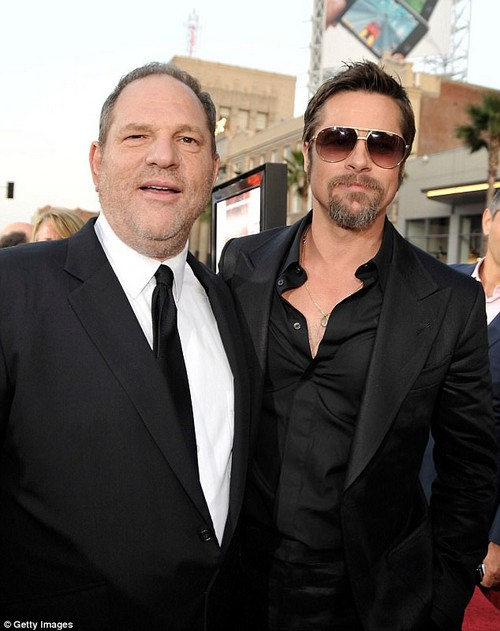 Brad Pitt confronted Harvey Weinstein (above together in 2009) at a theater premiere in the mid 1990s after being told by his then girlfriend Gwyneth Paltrow that he had propositioned her