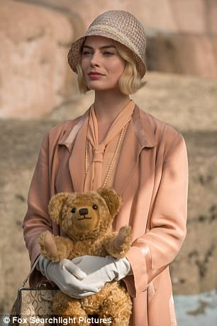 A.A. Milne is married tothe beautiful, fun-loving Daphne (Margot Robbie, a fine Australian actress whose cut-glass English accent, alas, is somewhat chipped around the rim)