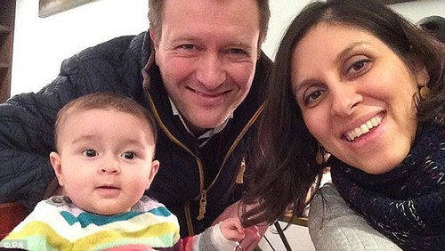 Iran does not recognize dual nationalities, so such detainees cannot receive consular assistance. In most cases, dual nationals have faced secret charges in closed-door hearings. Pictured: Richard Ratcliffe (centre) with Gabriella and Nazanin