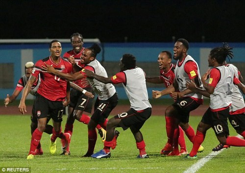 Trinidad's Alvin Jones celebrates his goal with team mates as the US were stunned