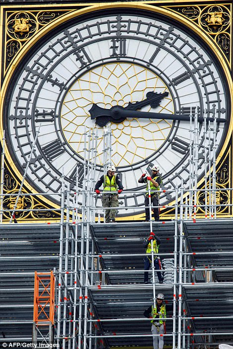 Men wearing hard hats, hi-vis jackets and safety harnesses were seen clambering up to the clock face of the 315ft structure in the heart of Westminster