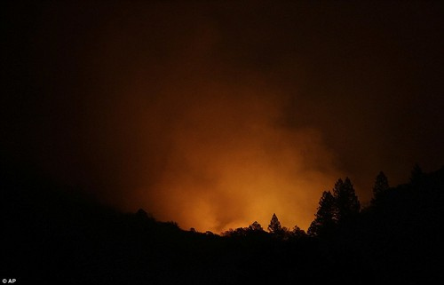 Fire from a distant mountain is seen from Kenwood on Tuesday as Napa and Sonoma counties continue to burn