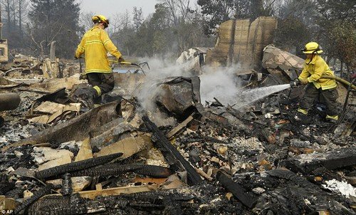 Firefighters have been working to get a control on at least 17 separate blazes since they broke out on Sunday (Picutred, Firefighters douse hot spots in the Coffey Park area of Santa Rosa)