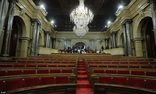 People waiting in the Catalan regional parliament in Barcelona as PresidentPuigdemont prepares to make a major speech during which he could declare independence