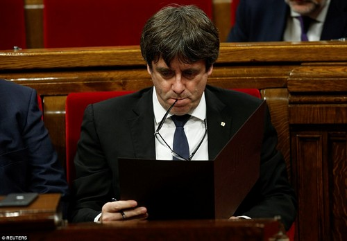 He also said:'They made us small - Spain - but Catalonia is a European affair. I am not going to make threats - the moment is serious. We have to assume our responsibilities'