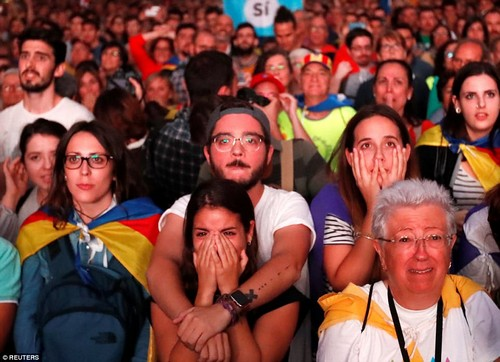 The president said that millions of Catalan citizens believe the region should have its own state, explaining that the region had won the right to be an independent country. Pictured: Crowds react to his speech